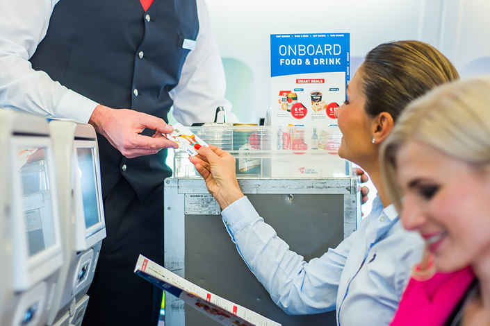 Women aboard a Czech Airlines flight ordering refreshments from the BUY-ON-BOARD menu