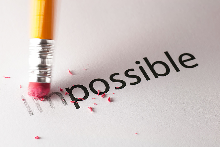 "The word ""Impossible"" written on a piece of paper, changed to ""possible"" with a pencil eraser"
