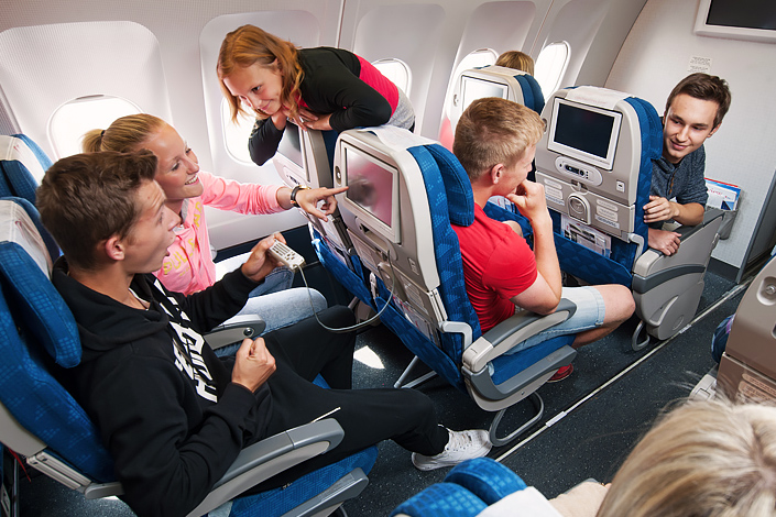 A group of students in the Economy Class of a Czech Airlines aircraft