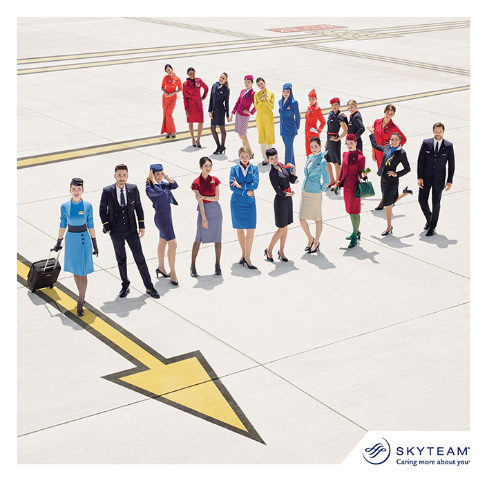 Pilot and flight attendants wearing SkyTeam alliance uniforms