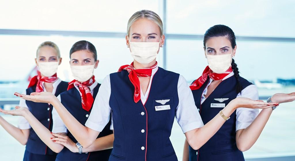 Letušky Českých aerolinií s ochrannými rouškami